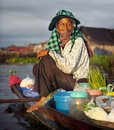 Local Cambodian seller in floating village. Royalty Free Stock Photo