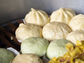 Local Chinese food steamed dumplings or steamed buns steaming in pot. Royalty Free Stock Photo