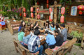 Local chinese people eating outside on the streets on ancient town of lijiang yunnan china Stock Images