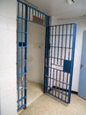 A local county small town jail cell in a police station Stock Photos