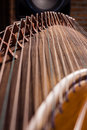 Local details of guzheng the or gu zheng chinese 古箏 also simply called zheng 箏 gu 古 means ancient is a chinese plucked Royalty Free Stock Photos