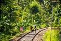 Local family in sri lanka walking on railway tracks