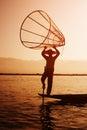 Local Fisherman Placing a Fish Trap in Inle Lake, Myanmar Royalty Free Stock Photo