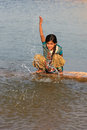 Local girl playing near water reservoir khichan village india rajasthan Stock Photography