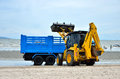 Local goverment use machinery cleaning bangsaen beach chonburi thailand july on july in the of chonburi thailand Stock Image