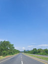 Local highway under blue sky photograph while travelling on vehicle at unspecific position central of thailand Stock Photo