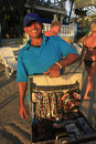 Local man selling jewelry at boca chica beach dominican republic Royalty Free Stock Photos