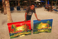 Local man selling paintings at boca chica beach dominican republic Royalty Free Stock Images