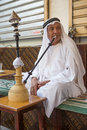 local man smoking shisha early in the morning at a cafe in dubai Royalty Free Stock Photo