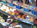 Local peoples sell fruits food and products at damnoen saduak floating market ratchaburi thailand september on september in Royalty Free Stock Photo