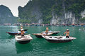 Local vietnamese paddle boats with women from a fishing floating village in halong bay vietnam Stock Photography