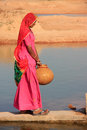 Local woman getting water from reservoir khichan village india rajasthan Royalty Free Stock Image