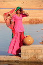 Local woman getting water from reservoir khichan village india rajasthan Stock Photos