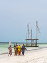 Local women going fishing on a beach in Zanzibar, Tanzania Royalty Free Stock Photo