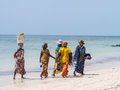 Local women going fishing on a beach in Zanzibar Royalty Free Stock Photo