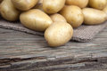 Locally grown potatoes on old wood lying Stock Photography