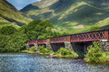 Loch awe bridge red near and kilchurn castle scotland Stock Photo