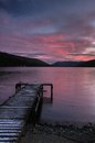 Loch earn in saint fillans with pier and coast Stock Photos