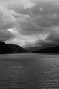 Loch lomond clouds cover the hills near Stock Photo