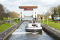 Lock gates and channels with boat sluice complex water filled reservoir passing cargo ship the netherlands Royalty Free Stock Photos