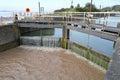 Lock gates at lydney docks onto the river severn Stock Photos