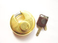 Lock and key a brass on white background Stock Photography