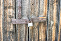 Lock on the old wooden gate Royalty Free Stock Photo