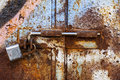 Lock on rusty iron door Royalty Free Stock Photography