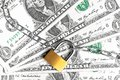 Lock security and chain on dollars banknotes background top of view of money for safety investment Royalty Free Stock Images