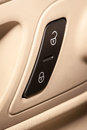 Lock unlock buttons and on the inside of door of passenger car Stock Photos