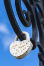 Lock with a vow of love to hanging on the iron lattice Royalty Free Stock Photo