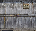 Locked old wooden door with sign Royalty Free Stock Images
