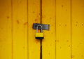 Locked photo of a yellow gate with a lock Royalty Free Stock Photos