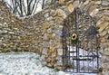Locked steel doors in stony wall Royalty Free Stock Photo