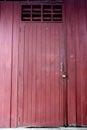 Locked wooden red door Royalty Free Stock Photo