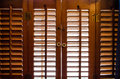 Locked wooden window shutters from the inside Royalty Free Stock Photo