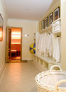 Locker room with bathrobes towels Royalty Free Stock Photo