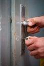 Locking a grey door Royalty Free Stock Photo