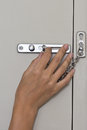 Locking up or unlocking door with hinge in hand Stock Photo