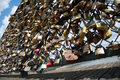 Locks on pont des arts bridge paris france in recent years many tourist couples have taken to attaching padlocks with their names Royalty Free Stock Image