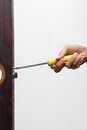 Locksmith fix lock on wooden door use old screwdriver the old Stock Image