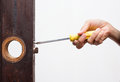 Locksmith fix lock on wooden door use old screwdriver the old Royalty Free Stock Photography