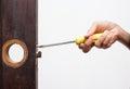 Locksmith fix lock on wooden door Royalty Free Stock Photo