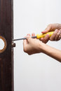 Locksmith fix lock on wooden door use old screwdriver the old Stock Images