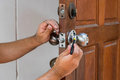 Locksmith have to fix silver knob Royalty Free Stock Photo
