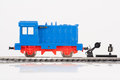 Locomotive and railway switch pictured items of a toy railroad Royalty Free Stock Photo