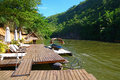 Lodge in the jungle of thailand floating dock on a river northern it is dock a reachable only by boat Stock Photo