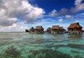 Lodges over transparent quiet sea water tropical paradise maldives a Stock Photo