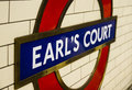 Lodon underground station sign earl s court in london at this is a blue police box known as a tardis from doctor who Stock Photo