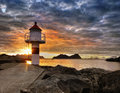 Lofoten, Sunset Coast and Lighthouse Royalty Free Stock Photo